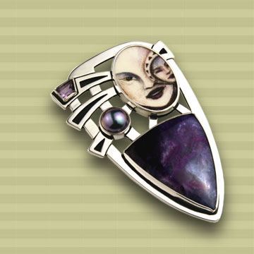 """INUA."" Silver pin-back pendant by Mary Mueller."